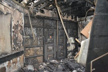 Photo showing fire damage behind fire doors